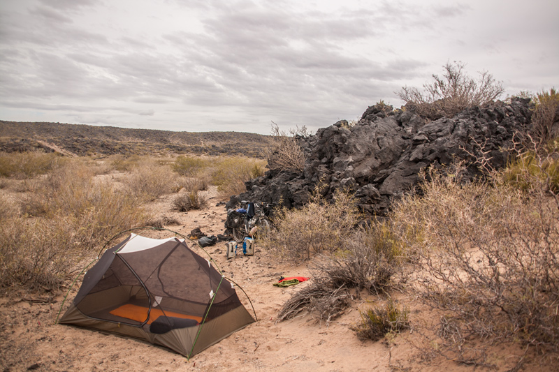 Camp spot at end of day 3.  A sandy lava field, the stove fails.  Then it starts to rain.